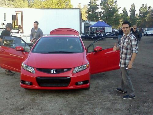 Beto posing in front of a Honda
