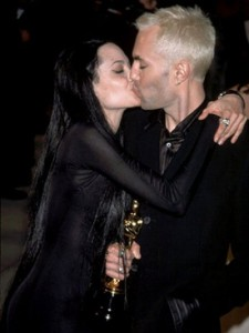 Angelina Jolie kisses her brother after the Oscars