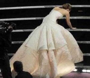 Jennifer Lawrence stumbles as she goes to accept her Oscar