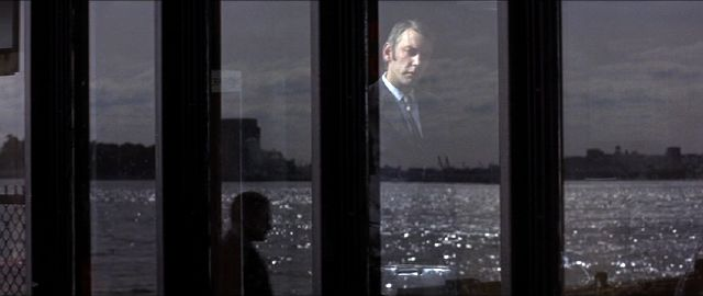 Donald Sutherland stares out the window in Klute