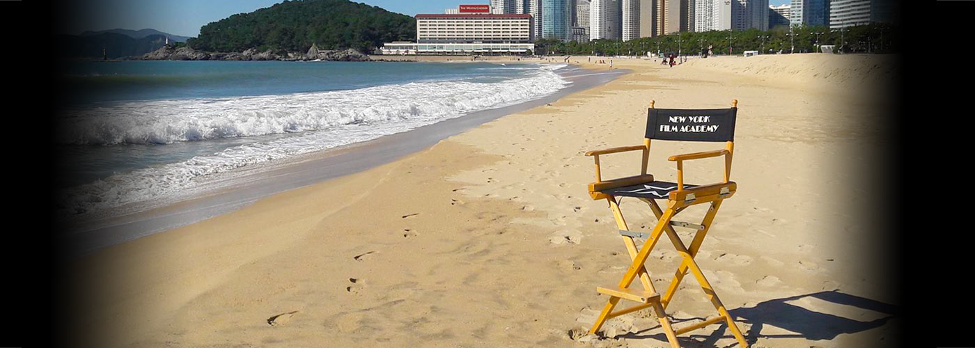 new york film academy director's chair on a beach
