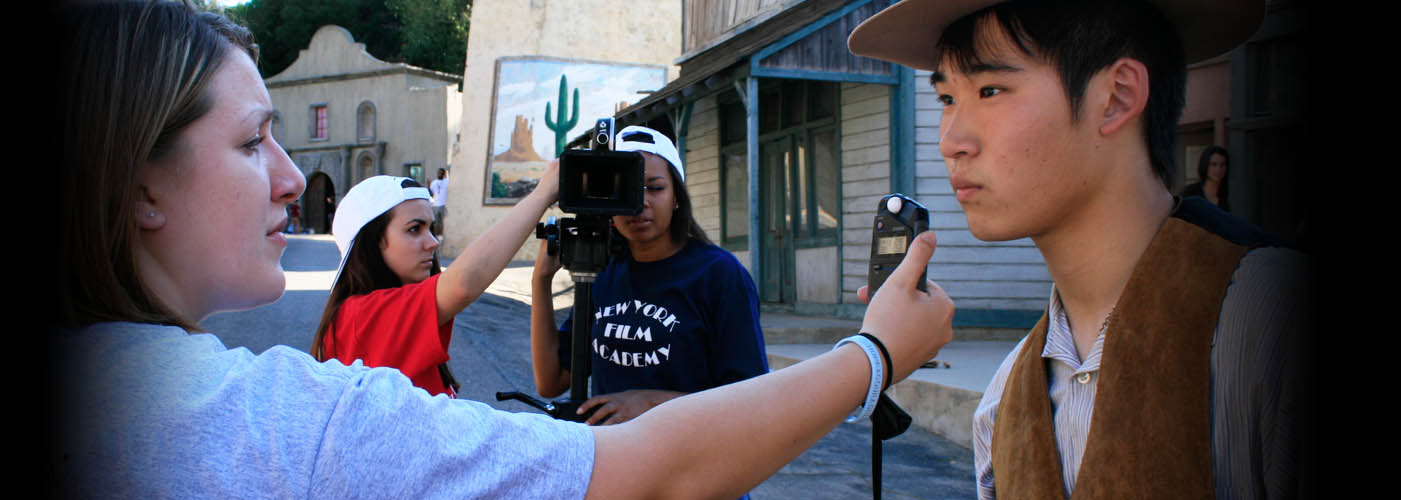 New York Film Academy acting student prepares for a take on set for a western scene.