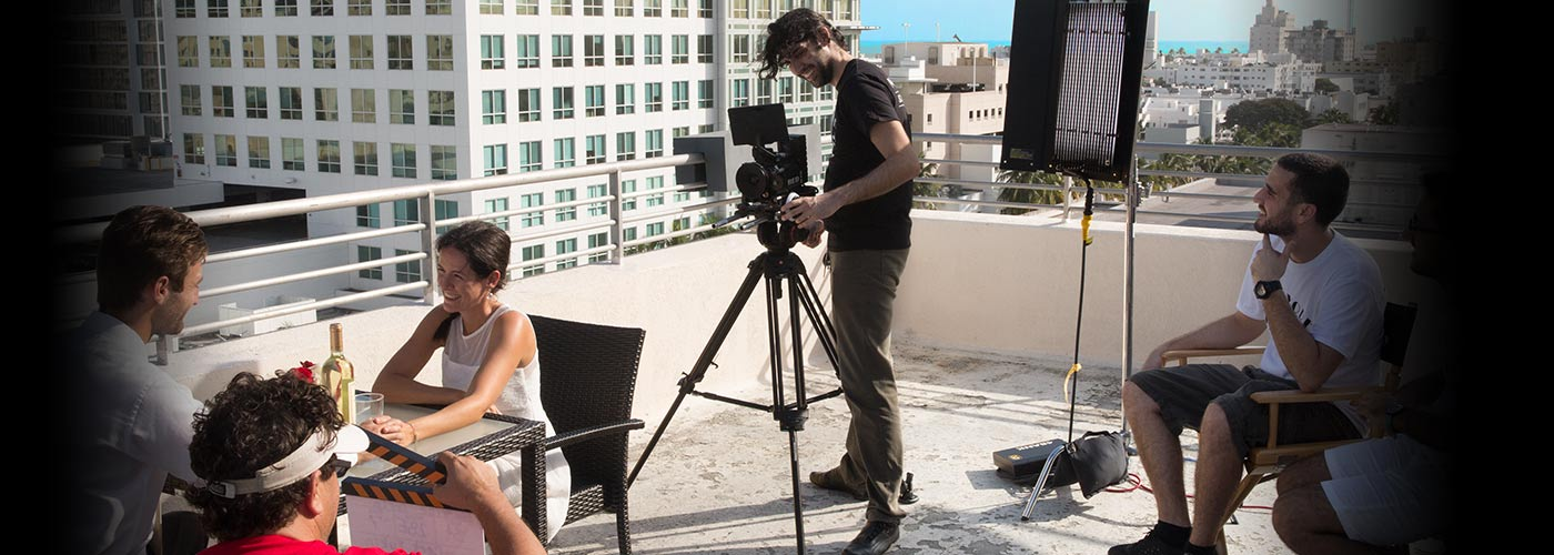 New York Film Academy acting students perform a brunch scene on a sunny rooftop.