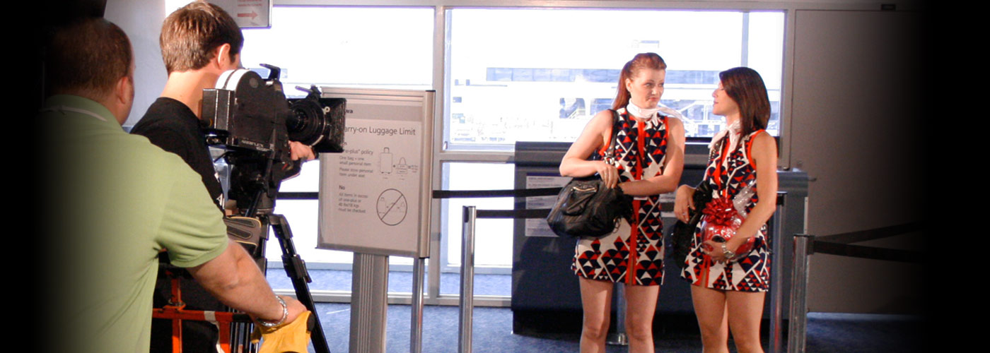 New York Film Academy acting students in matching outfits perform in an airline terminal.
