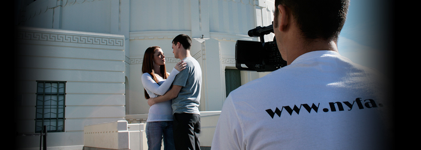 New York Film Academy acting students embrace for a take on location.