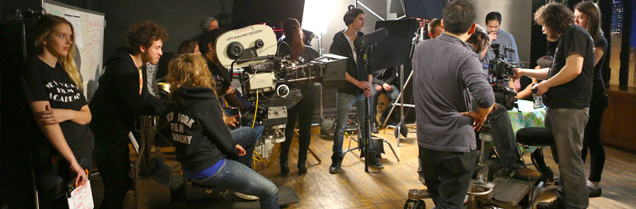 A large film crew prepares a shot