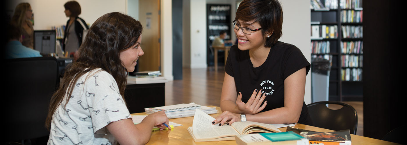 NYFA students studying at a library together