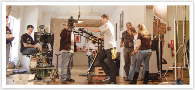 NYFA film school students operating cameras on set
