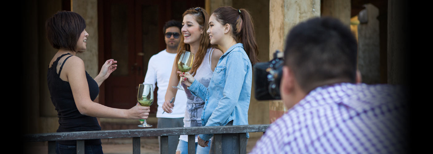 NYFA BFA acting students hold wine glasses on set