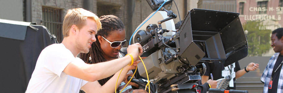 Two NYFA film school students operate a camera