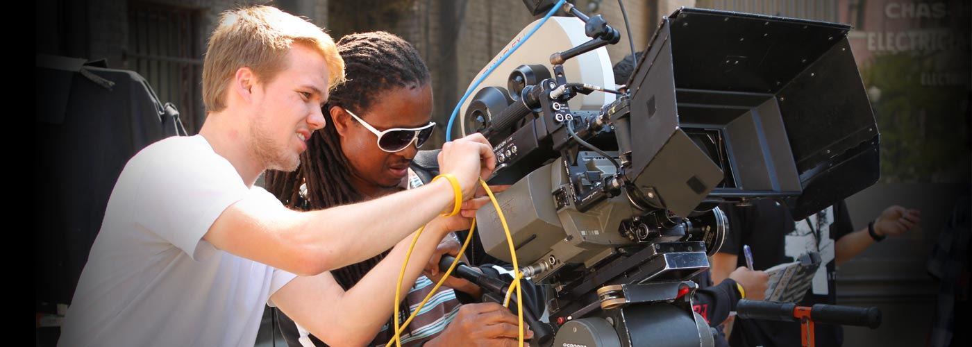 BFA film student setting up a camera