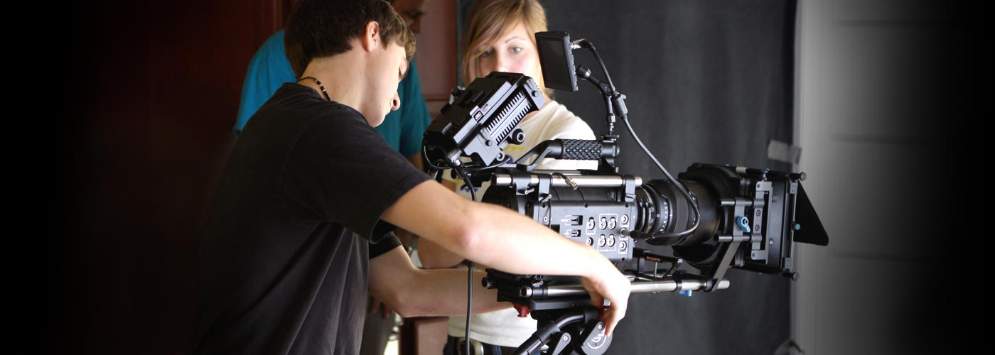 NYFA BFA film student adjusts camera on set