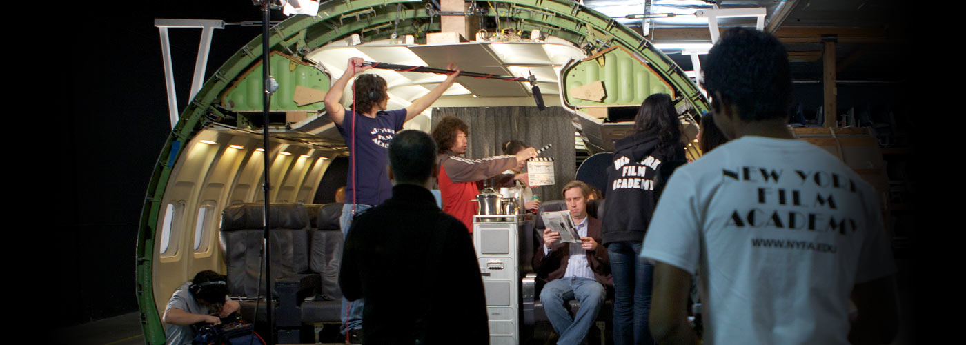 Producing students film in an airplane set