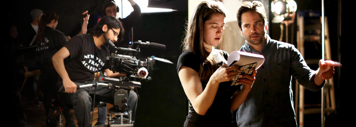 NYFA screenwriting school student reviews script on set