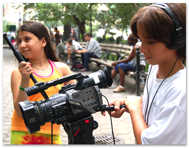 Filmmaking camp students operate a camera and record sound