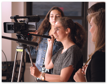 A NYFA film camp student learns to operate a camera