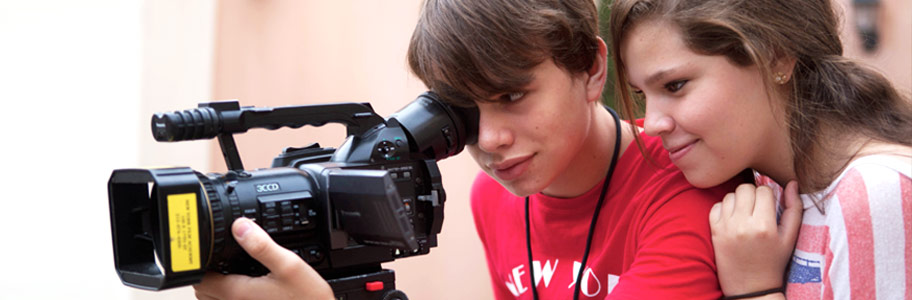 Two NYFA film camp students filming with a digital camera