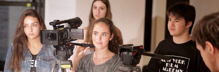 NYFA film camp students working as a crew on set