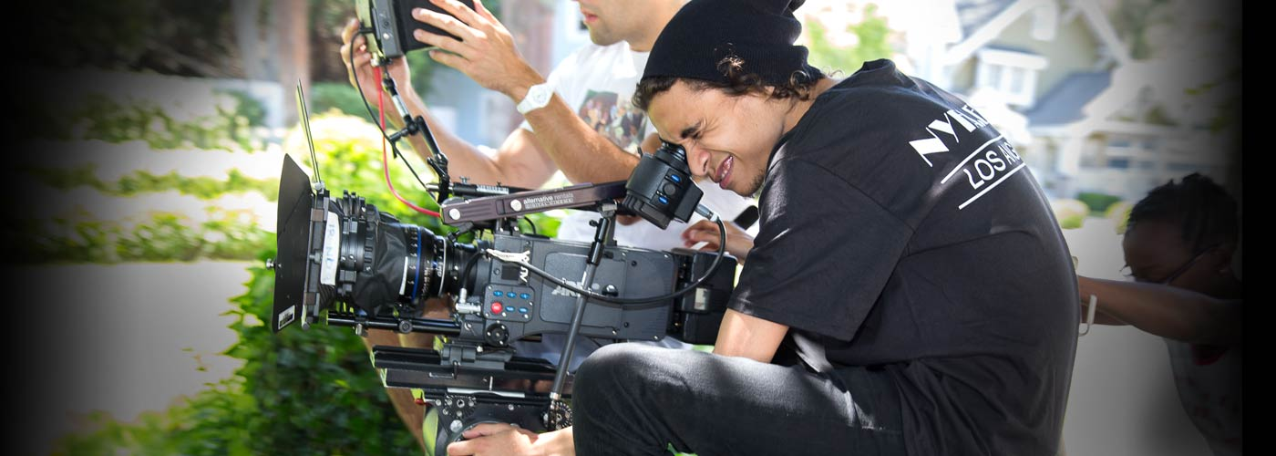 Cinematography school students film a scene on location