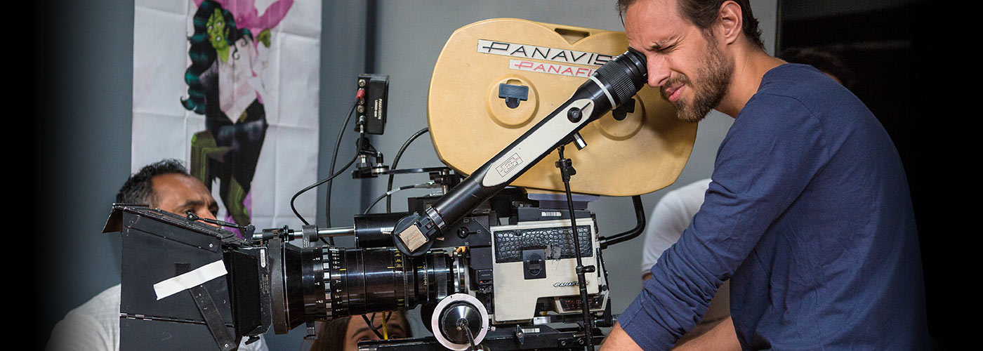 A New York Film Academy student uses a Panavision camera while shooting a set.