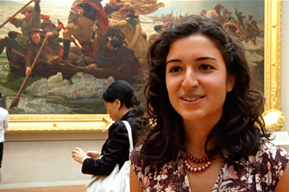 Student stands in front of painting at Metropolitan Museum