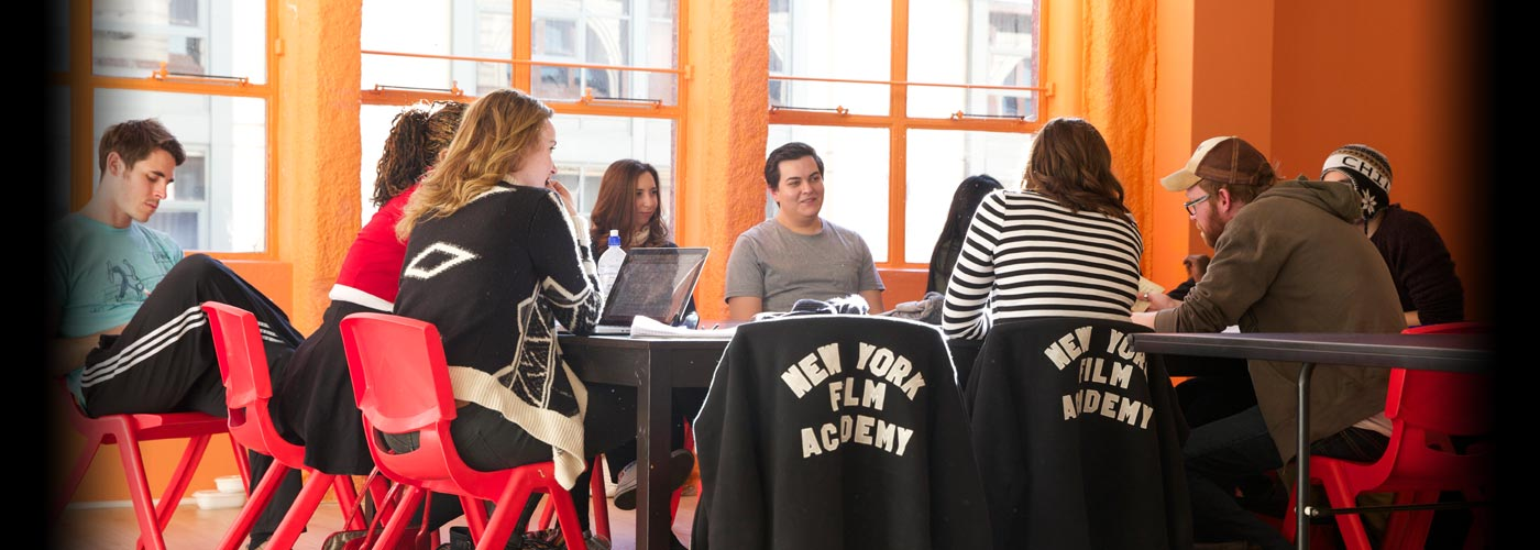 A group of NYFA students work on homework together