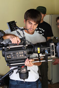 NYFA MA Film student adjusts the camera