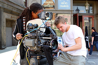 NYFA film school students operate a camera together