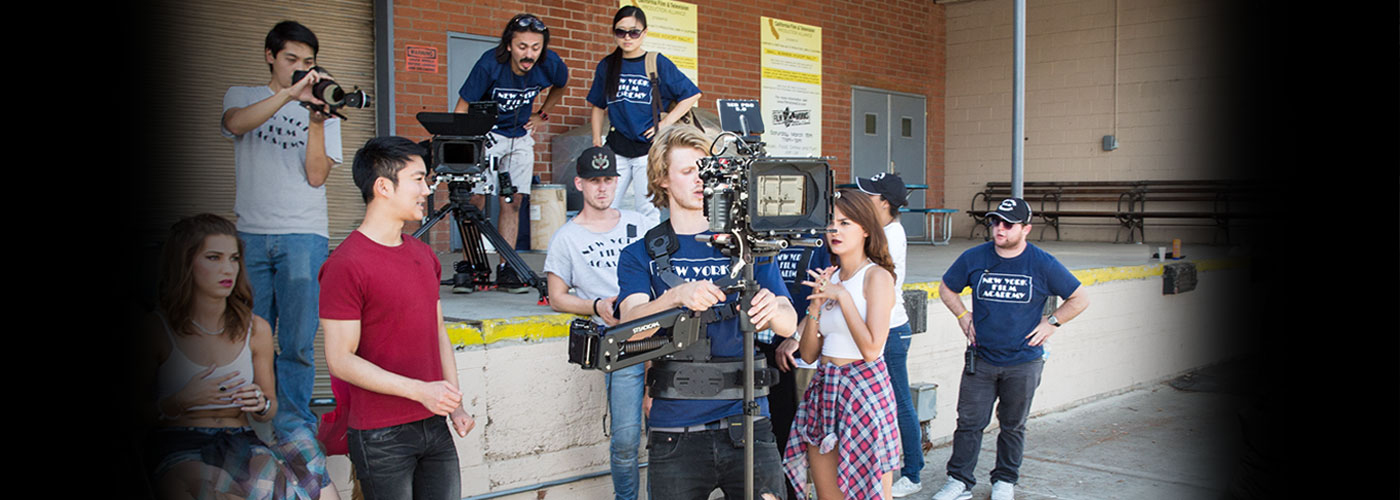 A student operates a camera with his crew at NYFA