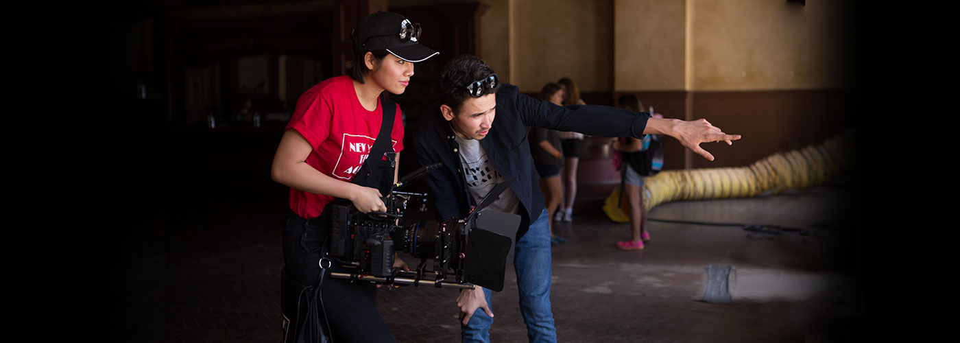 Two international students shoot footage at NYFA