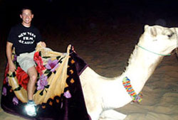 NYFA student on a camel in Abu Dhabi