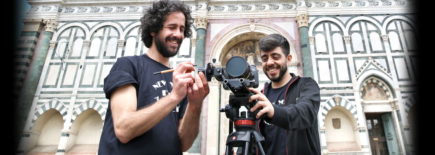 Two NYFA student crew members prepare to film.
