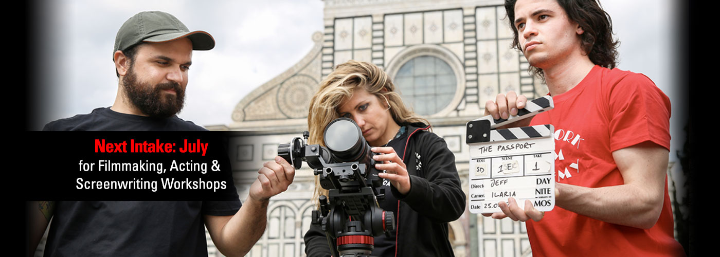 A NYFA Florence student crew of three slate for an outdoor shot in the city.