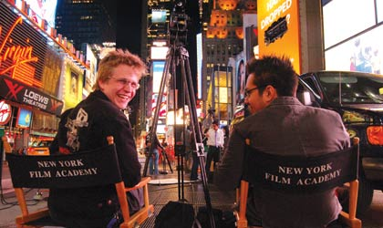 NYFA students sit in director chairs in Times Square