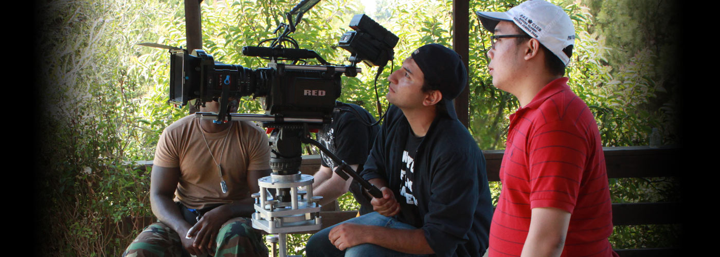 Cinematography school students operate a Red One digital video camera
