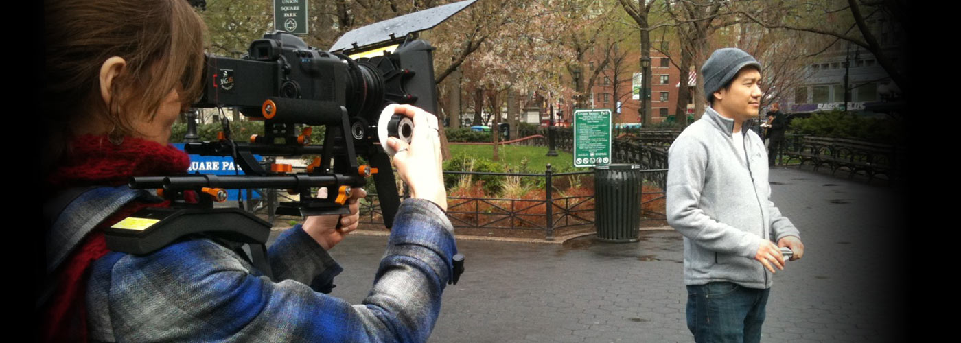 A NYFA documentary student films a subject in Union Square