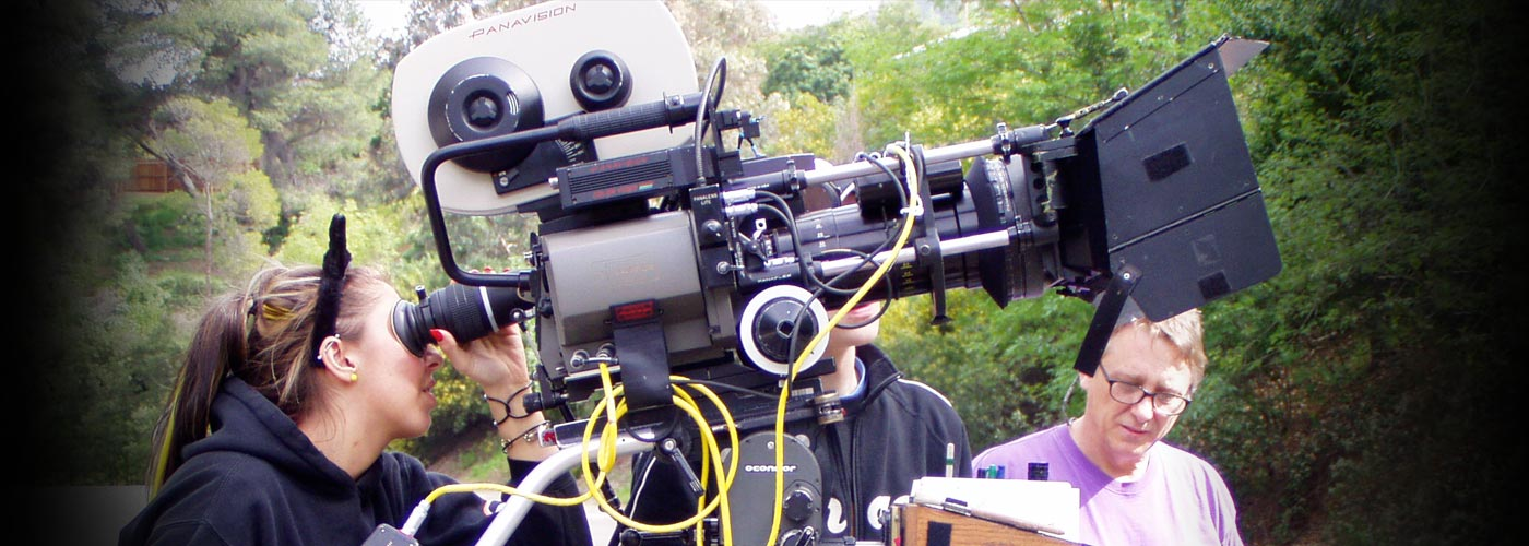 NYFA student operating a camera outdoors