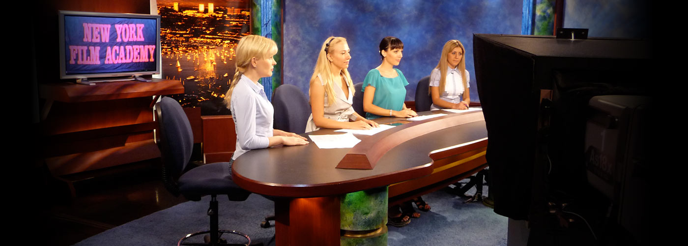 Four female broadcast journalism students practice as news anchors