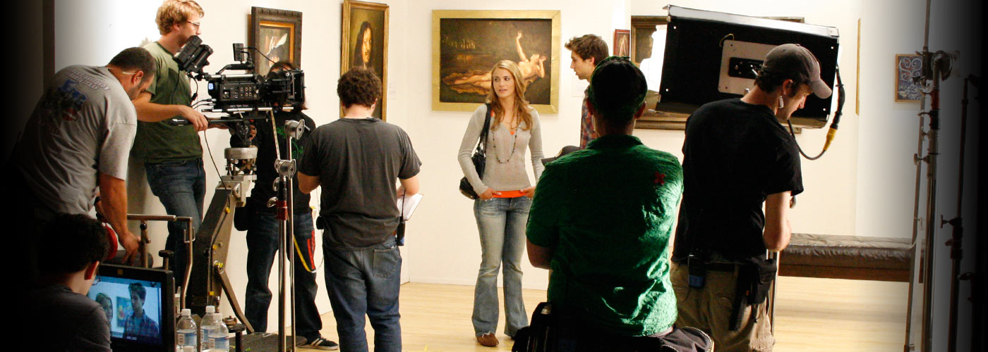 Acting school students film in an art museum