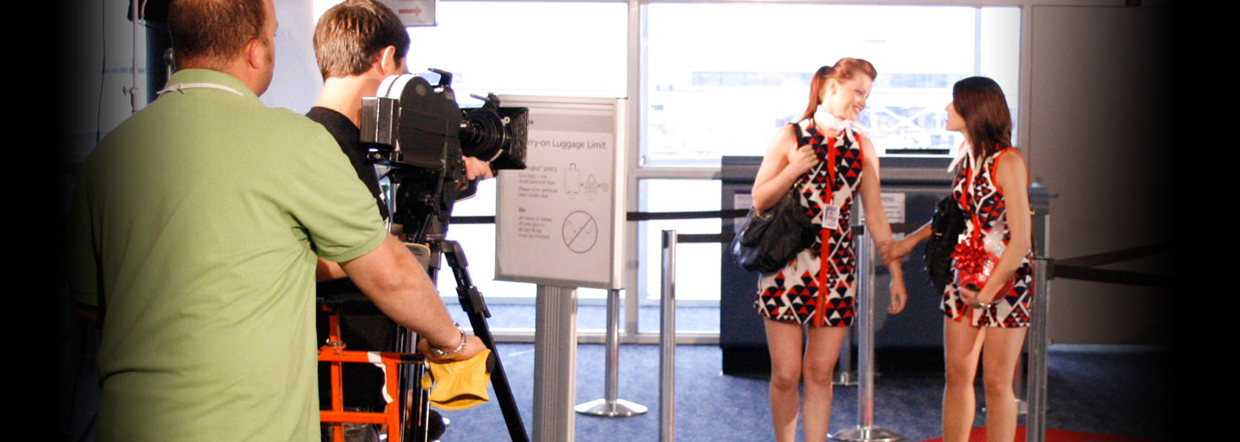 Actress filming a scene at an airport