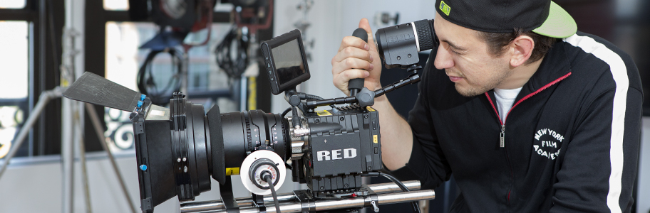 A NYFA film school student operates a Red One camera