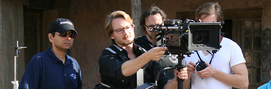 Students film with a digital camera on set