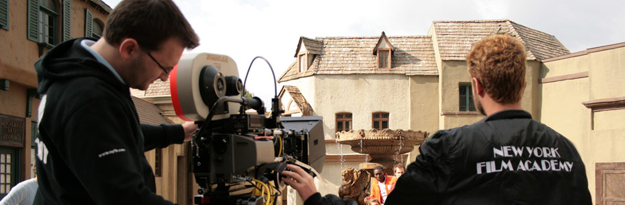 MFA film students operate a film camera on set
