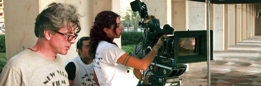 MFA Filmmaking students work with a film camera on set