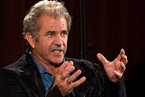 Mel Gibson speaking to the audience at a Q&A at NYFA