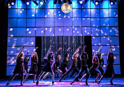 Musical Theatre Students Dance Under A Disco Ball On Stage