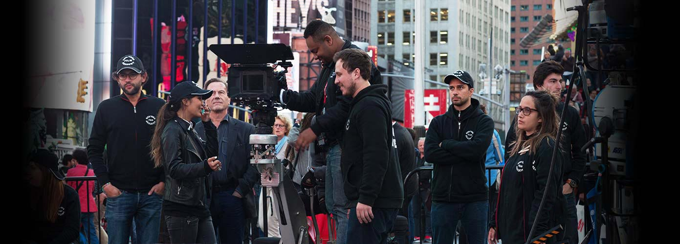 NYFA broadcast journalism students producing a segment together on location in Time Square.