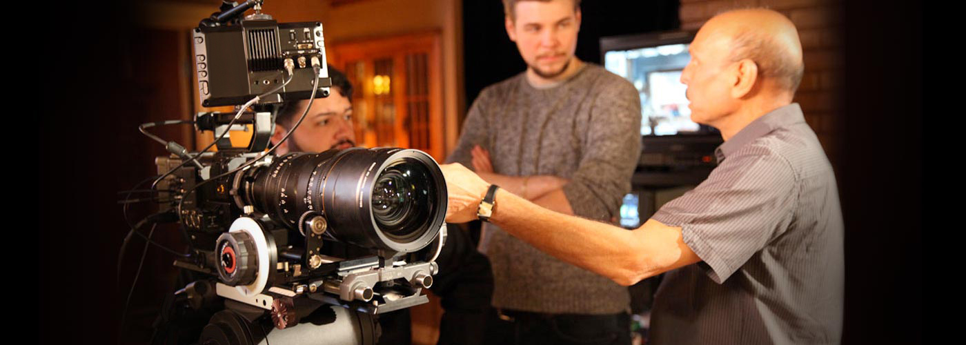 A NYFA instructor teaches a client how to use a RED camera