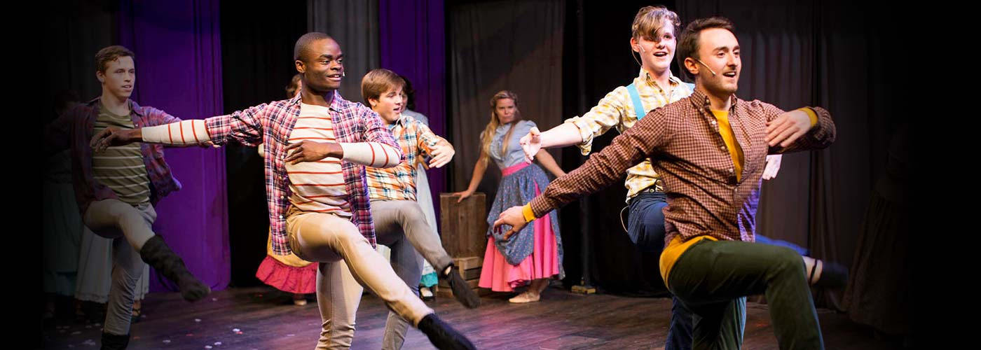 NYFA musical theatre ensemble performs a dance number in costume.