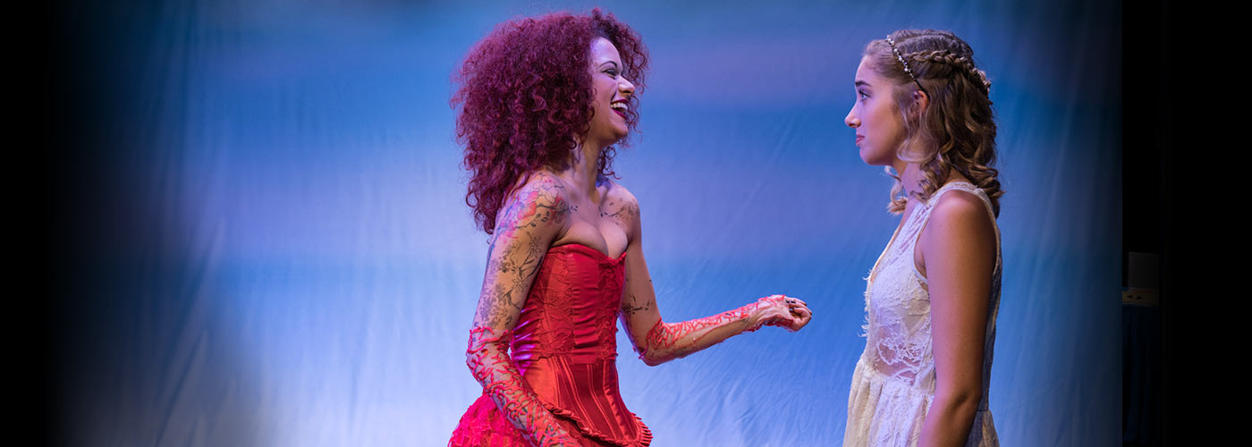 NYFA musical theatre students in glamorous lace costumes share a moment onstage in Eurydice.